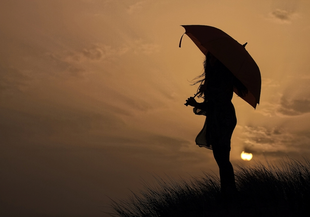 636126224513238992-317998745_alone-umbrella-girl-silhouette-abstract